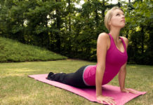 young woman stretching before exercise
