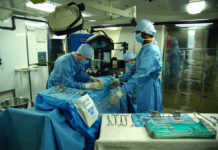 Doctors perform surgery in operation theatre
