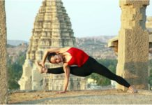 Lady practising yoga at Veerupaksha temple