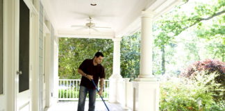 man cleans his house