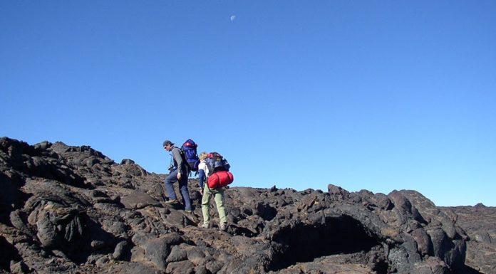 A couple climbing mountains