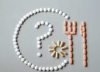 Pills with a question mark, fork and spoon