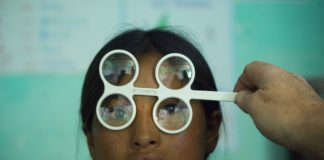 Poor girl getting eyesight test