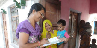 health worker collecting details of aayushman Bharat