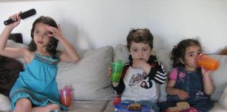 Kids watching TV and having junk food
