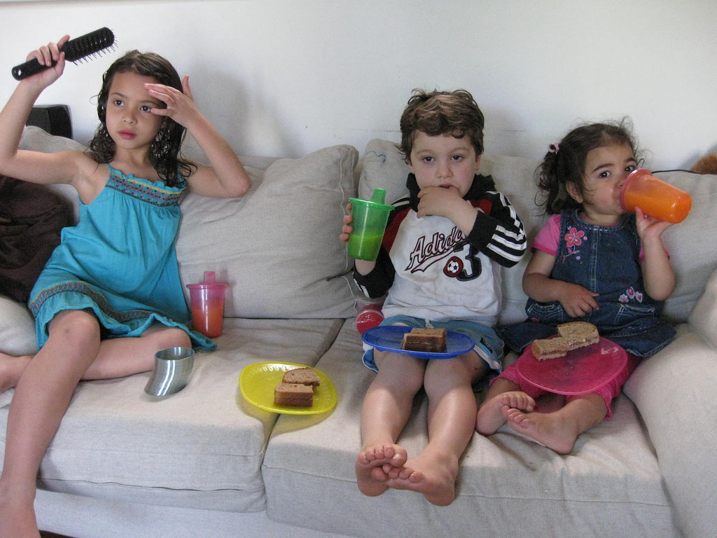 Kids watching TV and having junk food