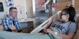 A patient recovering after surgery by listening to music