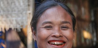 Woman chewing Pan tobacco