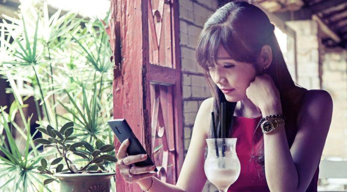 Depressed girl using phone