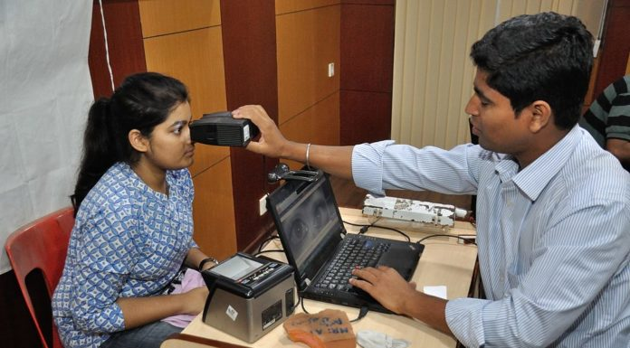 A lady gets her iris scanned for Aadhar card